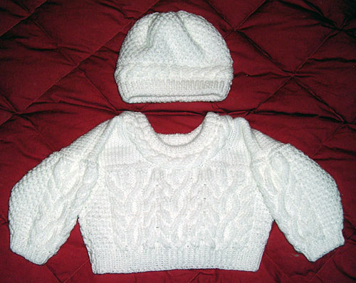 Knit wool baby sweater and matching hat